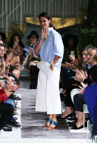 3.) Alessandra Facchinetti took her bow at the Tod's show today in an effortlessly stylish and entirely charming big blue shirt that is basically what we want to be living in come next spring.