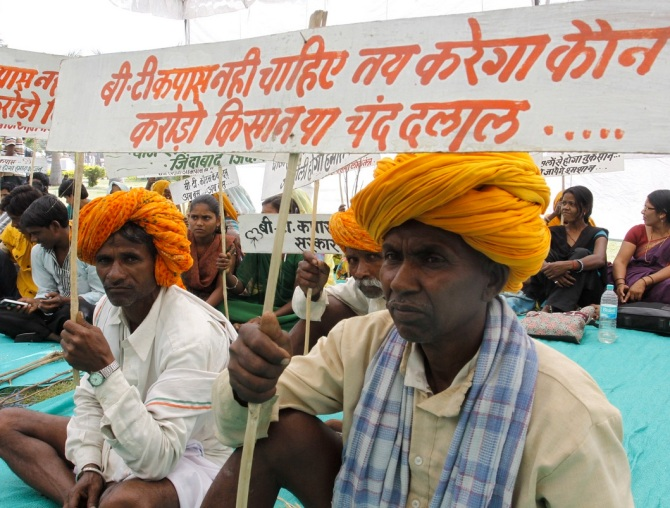 Indian tribal farmers hold placards as they take part in a demonstration against the United Progressive Alliance (UPA) government to protest against the promotion of multinationals in farming sector by the Indian government at the time in Bhopal, India, 31 March 2012. Farmers staged protests under the campaign 'Hamara Beej Abhiyan' or 'Our Seed Agitation' to protest against Monsanto, the US-based multinational agricultural biotechnology corporation, and other world trade organisations, demanding they leave India. The farmers claimed that one decade has completed for the BT cotton industry accepted in professional farming as a result of which farmers engaged in cotton farming have become helpless and poor by the day and also got debt-ridden and are compelled to commit suicide from time to time. The farmers alleged that with the introduction of genetically modified BT cotton in the country, such companies are monopolising the seed industry.