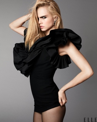 Dress by Saint Laurent. Earrings by Messika Paris. Tights by Wolford. Terry Tsiolis for ELLE