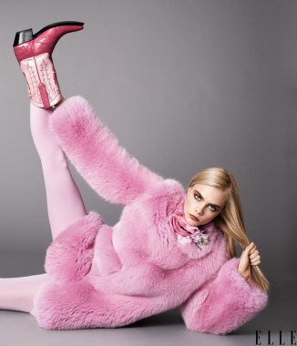 Coat and brooch by Gucci. Tights by We Love Colors. Boots by Space Cowboy Boots. Terry Tsiolis for ELLE